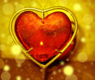Burning heart with flames against gold background Stock Photos