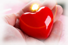 Burning heart in hand Royalty Free Stock Photo