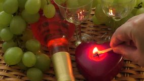 Burning heart shape candles and wine glass stock footage