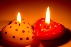 Burning heart shaped candles Royalty Free Stock Photos