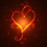 Burning heart with sparkles. On a dark background Royalty Free Stock Photo