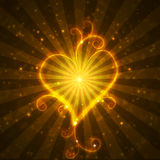 Burning heart with sparkles. On a dark background Stock Images