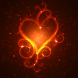 Burning heart with sparkles. On a dark background Royalty Free Stock Photography