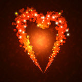 Burning heart with sparkles. On a dark background Royalty Free Stock Images