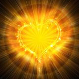 Burning heart. With sparkles on a dark background Stock Photography