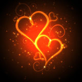 Burning hearts. With sparkles on a dark background Royalty Free Stock Images