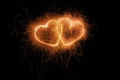 Burning hearts stock image