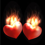 Burning hearts. Hearts burning with love and passion Royalty Free Stock Photography