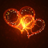 Burning hearts with sparkles. On a dark background Royalty Free Stock Photography
