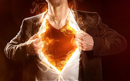 Burning Hero. Pulls up his shirt from the body Royalty Free Stock Photo