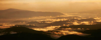 Burning hils. Carpatian mountains Ukraine sunset golden Royalty Free Stock Images