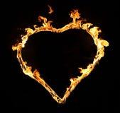 Burning hjärta med flammor. Isolerat Arkivfoto