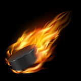 Burning hockey puck. Stock Photo