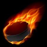 Burning hockeypuck Royaltyfri Bild