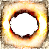 Burning Hole. Big burning fiery hole burst with white copyspace in the middle Stock Image