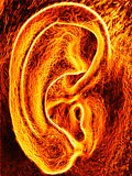 Burning hot human ear. Collage picture of human ear in flame Stock Image
