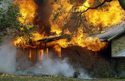 Burning house Stock Image
