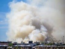 Burning house causes a big pile of smoke Stock Photos