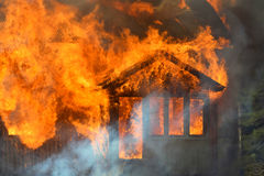 Burning house. Close up of burning house stock photos