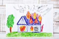 Burning house. Colorful drawing: burning house with flames stock photo