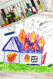 Burning house. Colorful drawing: burning house with flames royalty free stock photo