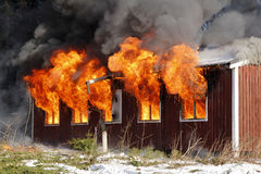 Burning house. Flames burst out from windows in a burning house royalty free stock photography