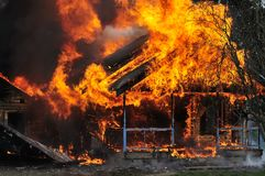 Burning house flames front view stock photography