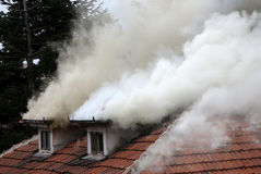 Burning house roof Stock Photography