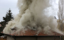 Burning house roof Royalty Free Stock Photos