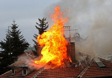 Burning house roof. Of a home stock images