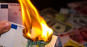 Burning hundred euro. A hundred euro bill in Europe currency is on fire Stock Photos