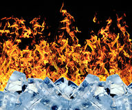 Burning ice cube. Abstracts Burning ice cube in black background Stock Photos