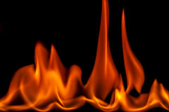 Burning ignited feul, fire,flames. Drops of flammable liquid ignited making red flames Royalty Free Stock Image