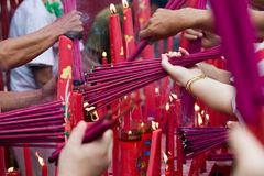Burning incense. Photo of people burning an incense at the temple Royalty Free Stock Images