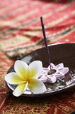 Burning incense. Placed in the plate on batik background Stock Images