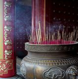 Burning Incense In Big Brass Cauldron. Burning Incense / Joss Sticks in a big brass cauldron at the entrance of a  Chinese Temple Royalty Free Stock Photography