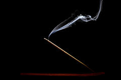 Burning incense on black background Royalty Free Stock Photos