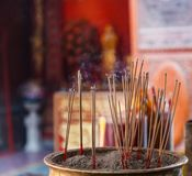 Burning Incense in Chinese Buddhist Temple background, material offering of traditional Mahayana Buddhist devotional practices for stock image
