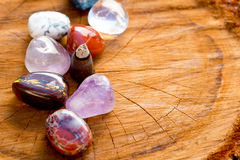 Burning incense cone with tumbled crystal stones on cross sectio Stock Image