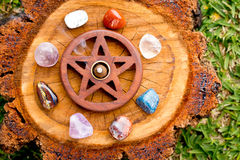 Burning incense cone  in wooden pentacle incense holder on natur Stock Images