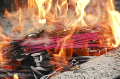 Burning incense and flames Royalty Free Stock Photography