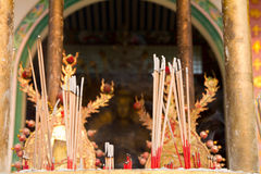 Burning incense in front of temple Stock Photos