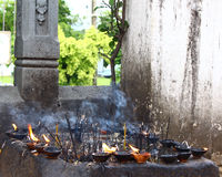 Burning incense and oil in a Buddhist temple Royalty Free Stock Images