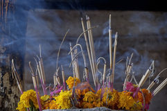 Burning incense  in Pac Ou Caves Laos. Smoke of burning incense  in Pac Ou Caves Laos Royalty Free Stock Photos