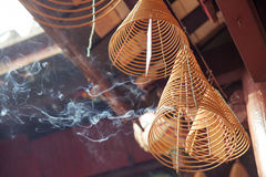 Burning incense in Quan Cong Temple, Vietnam Royalty Free Stock Photo