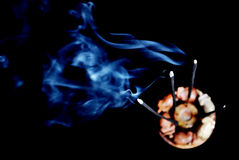 Burning incense with smoke Stock Photo