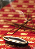 A burning incense stick Royalty Free Stock Images