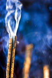 Burning incense stick. A closeup view of a burning incense stick Royalty Free Stock Photos