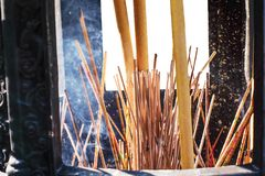 Burning Incense sticks in a big incense po. T at Chinese temple Stock Images