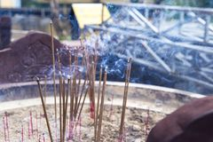 Burning incense sticks. In a special decorated bowl Royalty Free Stock Photo